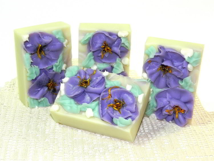 Handmade soap with piped flowers made in wooden slab soap mold